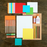Flat lay office tools and supplies. Education background with stationery on wood. Flat design of creative office workspace, workpl Royalty Free Stock Photo