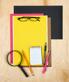 Flat lay office tools and supplies. Education background with stationery on wood. Flat design of creative office workspace, workpl Stock Images