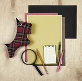 Flat lay office tools and supplies. Education background with stationery on wood. Flat design of creative office workspace, workpl Royalty Free Stock Images