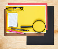 Flat lay office tools and supplies. Flat design and top view of workspace, workplace on desk. Stationery on wood background. Stock Image