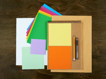Flat lay office tools and supplies. Flat design and top view of workspace, workplace on desk. Stationery on wood background. Stock Photo