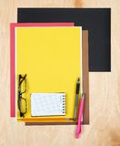 Flat lay office tools and supplies. Stationery on wood background. Flat design and top view of workspace, workplace on desk. Stock Image