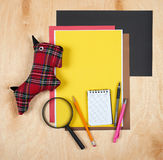 Flat lay office tools and supplies. Stationery on wood background. Flat design of workspace, workplace. Top view of desk backgroun Royalty Free Stock Photos