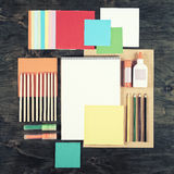Flat lay office tools and supplies. Top view of desk background. Stationery on wood. Flat design of creative office workspace, wor Stock Photo