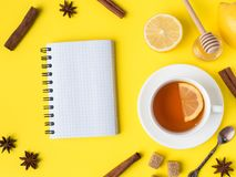 Free Flat Lay On The Yellow Bright Background Black Tea Lemon Cinnamon Star Anise Brown Sugar Jar Of Honey Notepad For Text Stock Image - 113040941