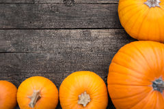Flat lay, orange Pumpkins on a wooden Table, copyspace Stock Photos