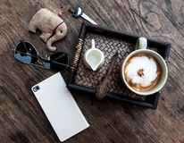 Flat lay out photography of wooden table at coffee shop. Royalty Free Stock Photos
