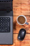 Flat lay overview lap top computer with mouse and cup of coffee Royalty Free Stock Photo
