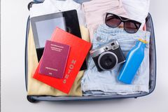 Packed clothes for summer holiday Royalty Free Stock Images
