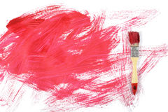 Flat lay of paintbrush with red gouache daub on white canvas. Art design Stock Photography