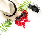 Flat lay Palm leaves sunglasses photo camera straw hat Royalty Free Stock Images