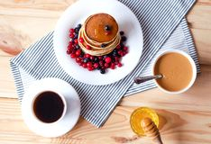 Flat lay with pancakes, honey, peanut paste and coffee royalty free stock image