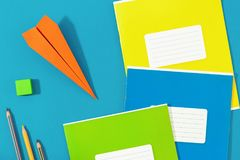 Flat lay paper airplane school supplies back to school concept Royalty Free Stock Image
