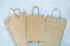 Flat lay of paper wastes as bags, boxes ready for recycling on gray background. Ecology care and social responsibility concept stock photos