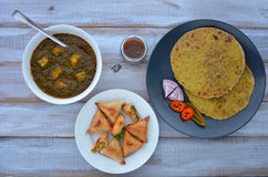 Flat lay of Paratha flatbread Indian cuisine served with traditi Royalty Free Stock Image