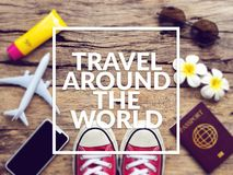 Flat lay of passport , mobile , plane model , red sneakers and traveler`s accessories items on wooden background Royalty Free Stock Photos