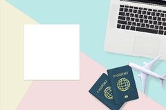 Flat lay of passport , white plane model and computer laptop stock images