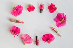 Flat lay pattern with pink flowers and female cosmetics. Beauty blog concept royalty free stock photos