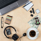 Flat lay of personal stuff, notebook computer,cards, coffee, money and other. Flat design and top view on desk as frame with blank. Center on wood background stock photo