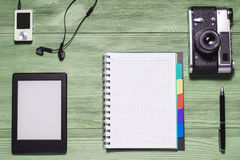 Flat lay of personal stuff, tablet pc, camera photo,notebook Royalty Free Stock Image