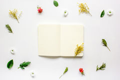 Flat lay with petals and copybook top view mock up Royalty Free Stock Image