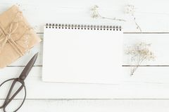 Flat lay photo of blank white notebook on wood table stock image