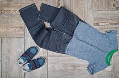 Flat lay photo of boy's casual outfit. Stock Photos