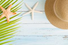 Flat lay photo coconut leaf and hat on wood background , top vie. W and copy space for montage your product stock photo