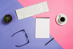 Flat lay photo of a creative freelancer woman workspace desk with copy space background. Image taken from above, top view. Minimal style with colorful paper royalty free stock image