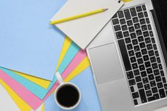 Flat lay photo of a creative workspace with multicoloured paper . royalty free stock image
