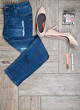 Flat lay photo of girl's jeans and accessories Royalty Free Stock Image
