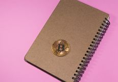Flat Lay photo with Notebook and Bitcoin Royalty Free Stock Photography