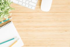Flat lay photo of office desk with mouse and keyboard ,Top view workpace on bamboo wood table and copy space. Flat lay photo of office desk with mouse and royalty free stock photos