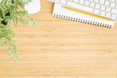 Flat lay photo of office desk with mouse and keyboard ,Top view workpace on bamboo wood table and copy space. Flat lay photo of office desk with mouse and royalty free stock images