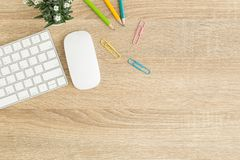 Flat lay photo of office desk with mouse and keyboard ,Top view workpace on wood table and copy space. Flat lay photo of office desk with mouse and keyboard ,Top stock photography
