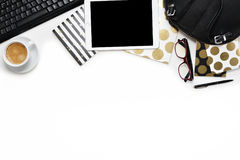 Flat lay photo of office white desk with tablet, keyboard and gold notebook copy space background. Flat lay photo of office white desk with tablet,keyboard and royalty free stock image