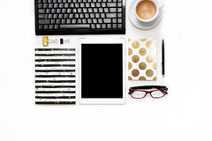 Flat lay photo of office white desk with tablet, keyboard and gold notebook copy space background stock photo