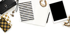 Flat lay photo of stylish office white desk with wallet, Women`s jewelry, keyboard and gold notebook copy space background Stock Image