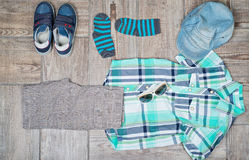 Flat lay photography of boy's casual outfit. Royalty Free Stock Photos