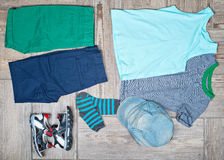 Flat lay photography of kid's casual outfits. Royalty Free Stock Image