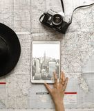 Flat Lay Photography of Person Touching Silver Ipad on World Map Chart Beside Black Hat Stock Images