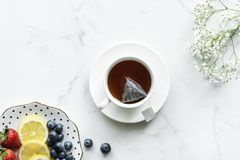 Flat Lay Photography of tea in White Teacup With Saucer royalty free stock photos