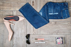 Flat lay picture of girl's jeans and accessories Stock Photo