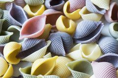 Close up heap colorful conchiglie pasta stock photos