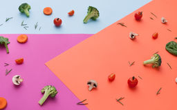 Flat lay of raw vegetables on abstract background. Diet, detox and healthy food concept - top view flat lay of fresh organic raw vegetables on abstract bright Stock Photography