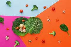 Flat lay of raw vegetables on abstract background. Diet, detox and healthy food concept - top view flat lay of fresh organic raw vegetables on abstract bright Royalty Free Stock Images