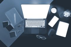 Flat lay x-ray photo of Office table with laptop computer, notebook, digital tablet and mobile phone. Flat lay x-ray photo of Office table with laptop computer Stock Images