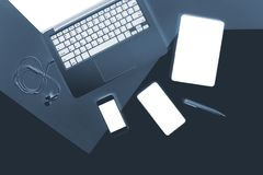 Flat lay x-ray photo of Office table with laptop computer, notebook, digital tablet and mobile phone. Flat lay x-ray photo of Office table with laptop computer Stock Image