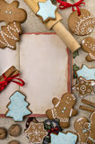 Flat lay of recipe book and christmas gingerbreads Stock Photos