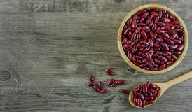 Flat lay red beans in wooden bowl with copy space. Flat lay,top view red beans in wooden bowl and spoons and grey wooden table with copy space Stock Image